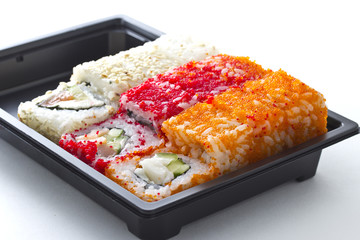 Set of sushi in black plastic box
