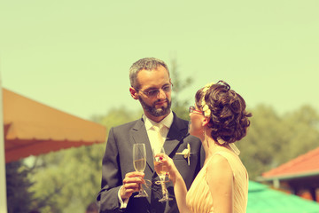 Bride and groom with glass of champagne
