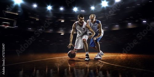 canvas print picture Two basketball players in action