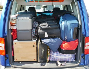 Suitcases and bags in the luggage boot of a car