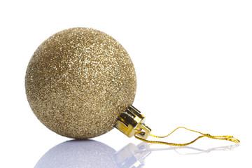 Golden shiny christmas ball isolated on white background