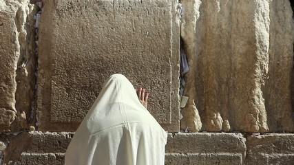 Orthodox Jewish man pray at the wailing wall, Jerusalem - Israel