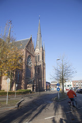 curch and bicycle on street of Woerden