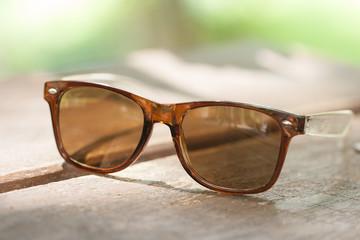 Sunglasses on wood table.