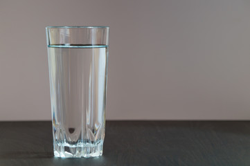 A tall glass with clean water in it