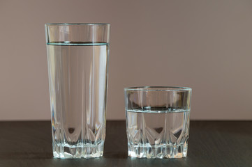 Two different height glass containing clean water
