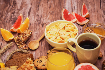 tasty breakfast with corn flakes, pie and juice