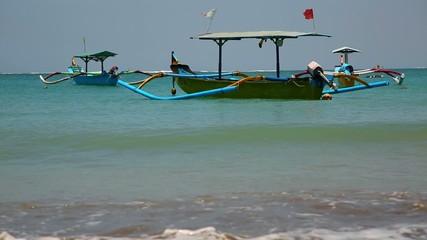 fishing boats lie down on a tropical beach