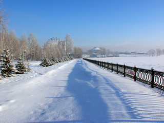Snow-covered embankment winter city park
