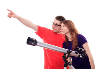 Two people observe through a telescope