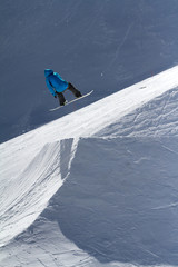 Snowboarder jumps in Snow Park,  ski resort