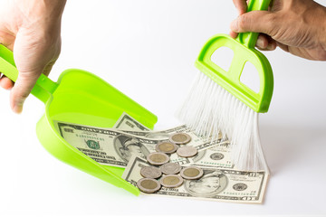 sweeping money using broom and scoop