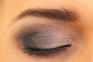 close female eye with make-up, macro