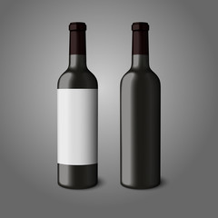 Two blank black realistic bottles for red wine isolated on grey