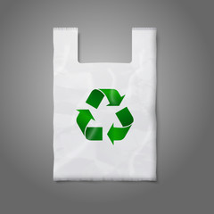 Blank white plastic bag with green recycling sign, isolated on
