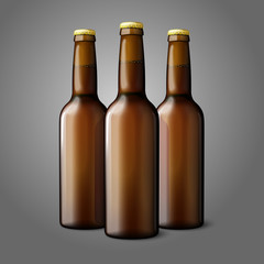 Three blank brown realistic beer bottles isolated on grey