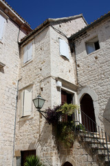 Old house in Trogir with white stone facade