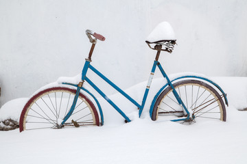 old bicycle covered with snow