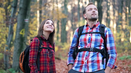 Young couple admiring view of the autumn forest