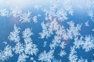 sunbeam spots and frosty pattern on window pane