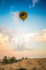 yellow balloon above the earth