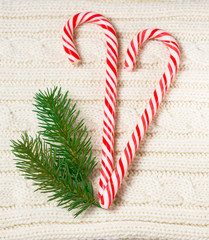 Knitted wool texture with christmas decoration and candy cane
