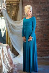 Woman in blue dress in luxury interior