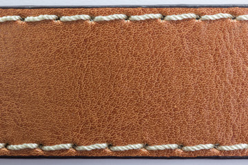 Brown Leather with thread sewed texture background