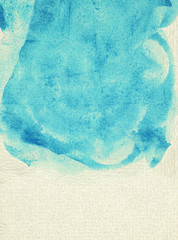 Painted blue watercolor background on brown paper with splatter