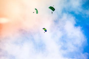 three athletes parachutist fly