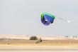 parachutists a touchdown - 73743289
