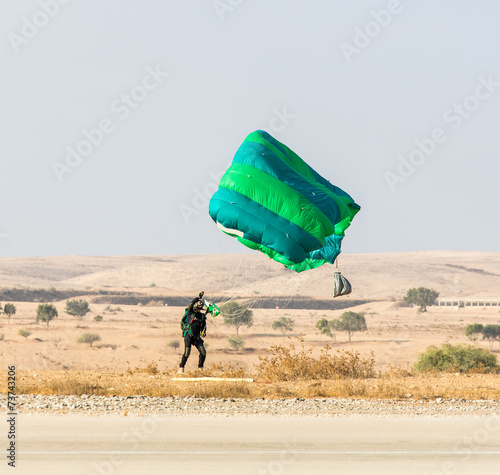 athlete landed safely by parachute - 73743206