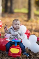 Close up portrait of beautiful little baby boy, outdoor portrait