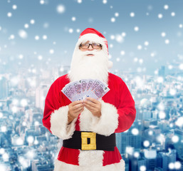 man in costume of santa claus with euro money