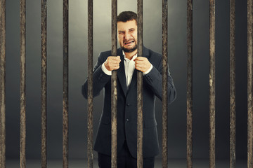 man behind the prison cell
