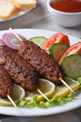 kebabs with ketchup and fresh vegetables vertical