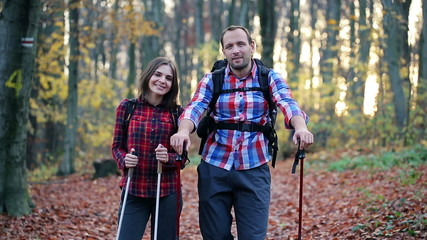 Portrait of happy, smiling couple hikers in the forest