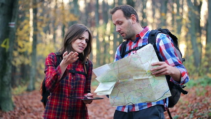 Lost couple fight over map tablet and map in forest