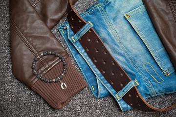 Fashion trend: jeans, leather jacket, leather belt, bracelet