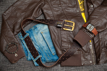 leather jacket, jeans with a belt, shirt, watch and bracelet