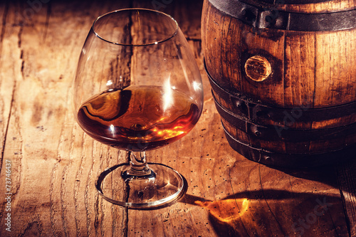 Fotobehang Alcohol Strong alcohol on a wooden table and barrel