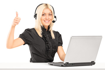 Female call service operator giving a thumb up
