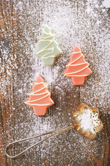 pink christmas tree homemade sweets  in rustic style on wooden d