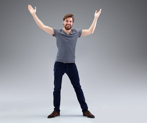 Young man with beard in victory pose