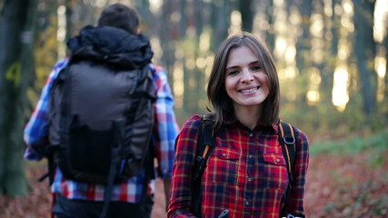 Portrait of happy female hiker in autumn forest