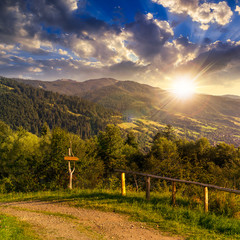 fence on hillside in mountain at sunset