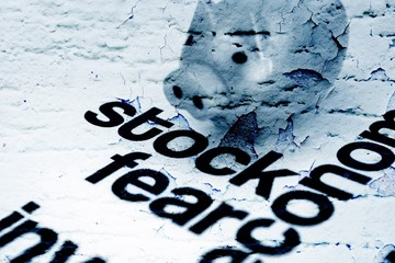 Stock and fear concept on grunge background