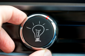 Button with a hand-drawn illuminated light bulb