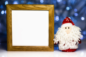 Santa Claus and blank wooden frame