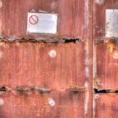 old rusty gate with signs